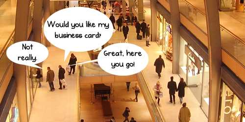Handing out business cards whilst shopping